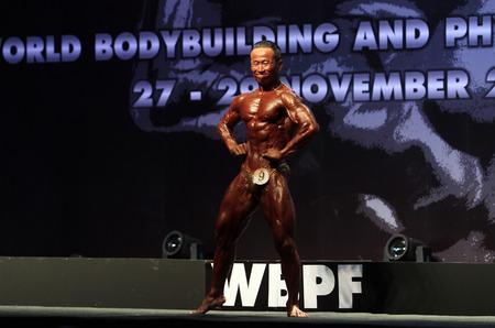 Bangkok - November 27:Chuluunbazar Myanganbileg of Mongolia in action during WBPF World Bodybuilding and Physique Sport Championships 2015 at MCC Hall The Mall Bangkapi on November 27, 2015 in Bangkok, Thailand. 報道画像