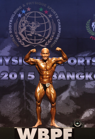 Bangkok - November 27:Malvern Abdullah of Malaysia in action during WBPF World Bodybuilding and Physique Sport Championships 2015 at MCC Hall The Mall Bangkapi on November 27, 2015 in Bangkok, Thailand.