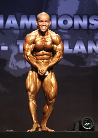 Bangkok - November 27:Jefry Johanis Wuaten of Indonesia in action during WBPF World Bodybuilding and Physique Sport Championships 2015 at MCC Hall The Mall Bangkapi on November 27, 2015 in Bangkok, Thailand. 報道画像