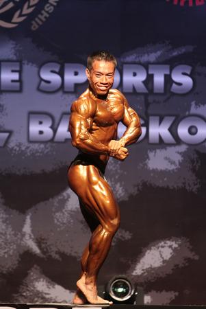 Bangkok - November 27:Nguyen Anh Thong of Vietnam in action during WBPF World Bodybuilding and Physique Sport Championships 2015 at MCC Hall The Mall Bangkapi on November 27, 2015 in Bangkok, Thailand.