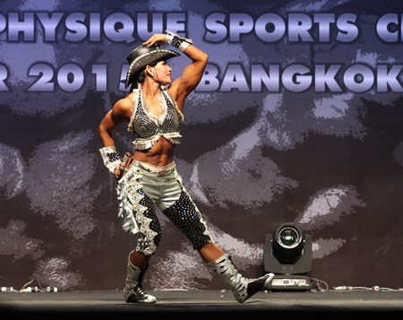 Bangkok - November 27:Nongyao Koseenam of Thailand in action during WBPF World Bodybuilding and Physique Sport Championships 2015 at MCC Hall The Mall Bangkapi on November 27, 2015 in Bangkok, Thailand. 報道画像