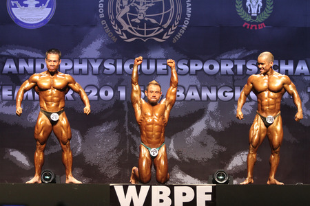 Bangkok - November 27:Jiraphan Pongkam(29) of Thailand in action during WBPF World Bodybuilding and Physique Sport Championships 2015 at MCC Hall The Mall Bangkapi on November 27, 2015 in Bangkok, Thailand.