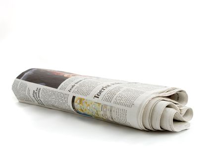 rolled: rolled up Dutch Newspaper