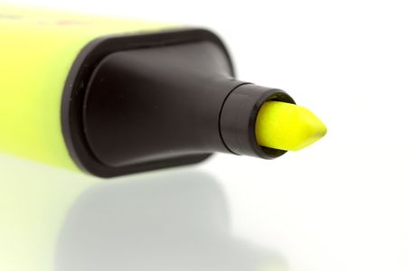 Yellow marker on shiny reflecting surface - close up photo