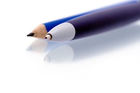 Blue pen and blue pencil on shiny reflecting surface - isolated on white