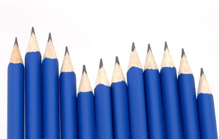 primarily: Sharp blue pencils in a swirley row