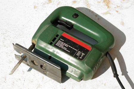fret: Used electric fret saw with sawdust