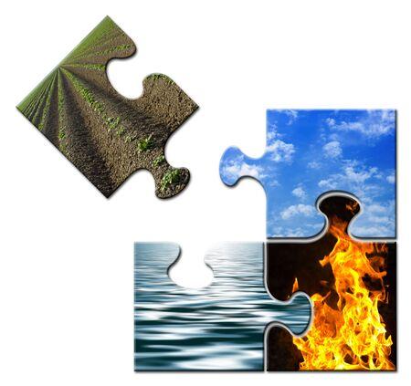 cuatro elementos: Cuatro elementos de un rompecabezas - Tierra aparte  Foto de archivo