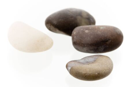 Four different colored pebbles in a group on a white surface. High key shot with shallow depth of field. Very high resolution image. Stock Photo - 3480080