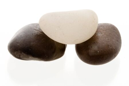 Very high resolution image. White pebble on top of two dark pebbles. High key shot. Stock Photo - 3480082