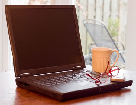 Laptop Coffee Cup Glasses and Cell Phone in Home environment Stock Photo - 3794133
