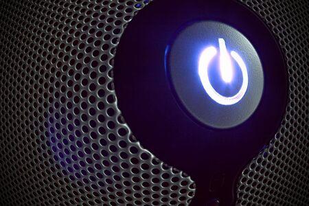 powerbutton: Bot�n de encendido en el panel perforado efecto ojo de pescado Foto de archivo