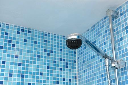 shower head again blue mosaic tiles