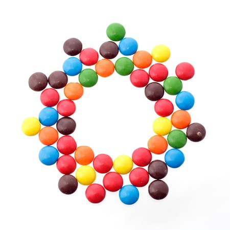 colorful candy in a circle - copy space in the middle photo