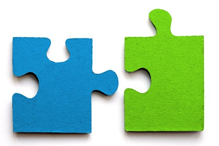 jigsaw: bright blue and green jig saw pieces