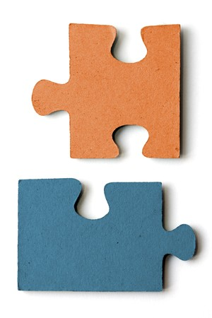 blue and orange jig saw pieces photo