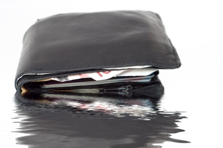 Old Leather Wallet with Money drowning in water photo