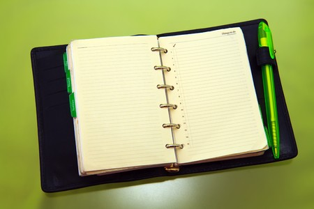 things to do: Organizer with green pen opend on things to do page