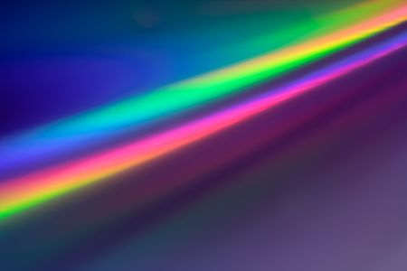 Abstract backgound in Rainbow colors reflection on the surface of a DVDCD Stock Photo