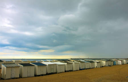 Wooden beach houses in a row photo