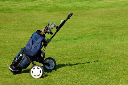 Blue golf bag on green fairway Stock Photo