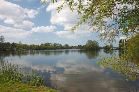 Landscape with pond reflecting the sky Stock Photo - 4803667