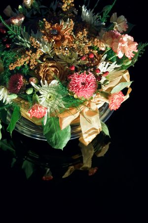 Flower Bouquet with ribbon on reflecting black background photo