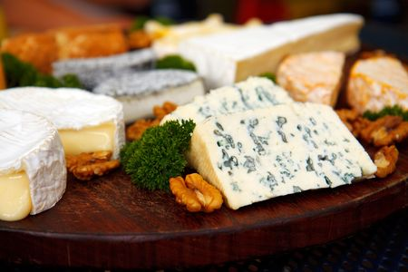 Cheese plate with blue cheese, parsley and wall nuts photo