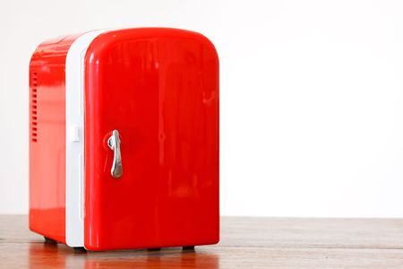 Shiny bright red miniature fridge photo