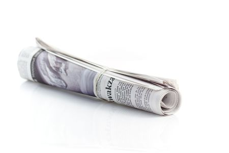 Rolled up newspaper with rubber band