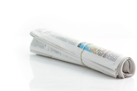 Rolled up newspaper with rubber band photo