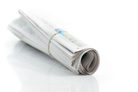 Rolled up newspaper with rubber band Stock Photo - 6258608