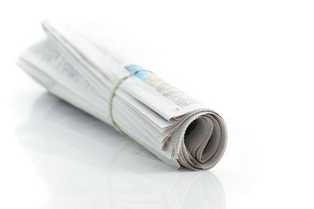Zusammengefasste Zeitung mit Gummi-band Standard-Bild - 6258608