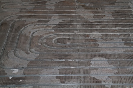 close-up shot of floor with just installed underfloor heating photo