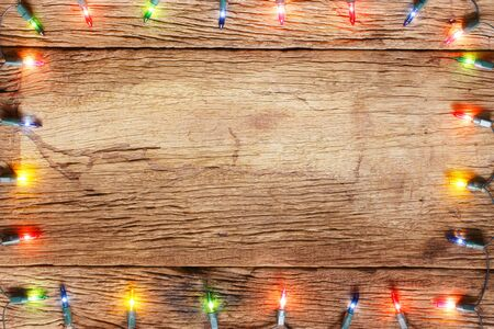 wood backgrounds: christmas light decorations on wood texture