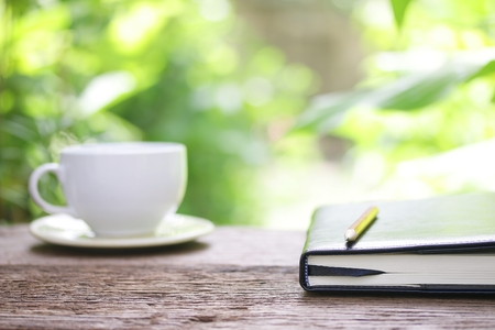 wood grass: Notebook  and coffee on wooden table