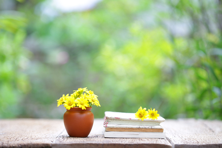 Flower and brown pot with notebook
