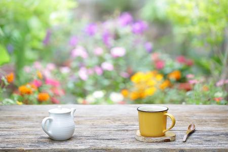 white vintage  teapot  with yellow mug Stock Photo