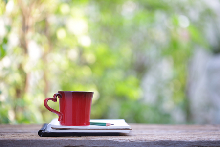 Red cup and notebooks at outdoor Stock Photo