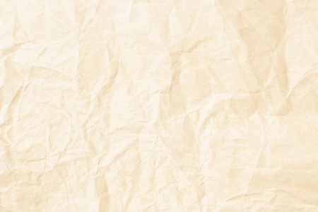 Crumpled pale yellow paper texture Stock Photo