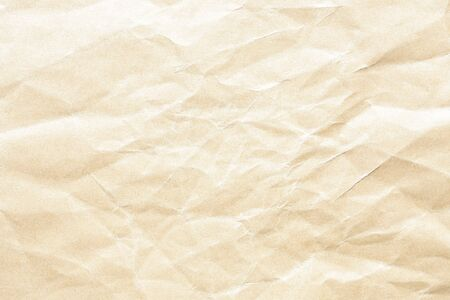 Old pale yellow crumpled paper background texture