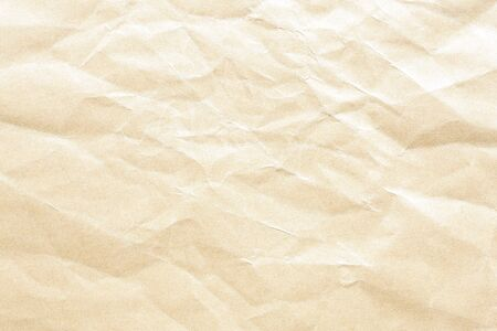 Old yellow crumpled Kraft paper background texture