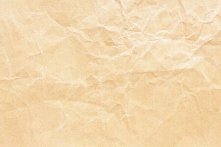 Old yellow crumpled Kraft paper background texture Stockfoto - 130666178