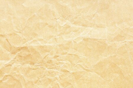 Old yellow crumpled Kraft paper background texture Stockfoto - 130666221