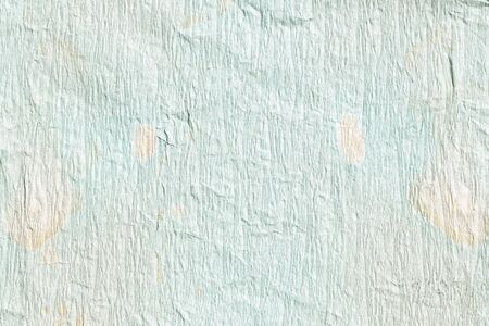 Old crumpled soft Blue with orange stained paper background texture