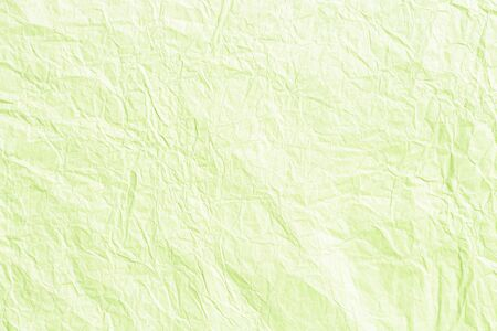 Old crumpled lime green paper background texture