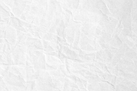 Crumpled white grey paper background texture