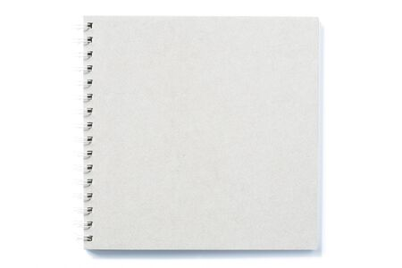 Grey notebook with ring binder on isolated white background paper texture