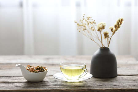 A cup of Lemongrass and Pandanus leaf herb with dry flower in clay pot