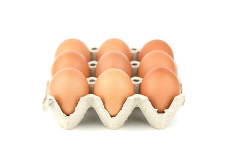 White Isolated eggs in carton tray Banque d'images